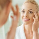 dermatology beautiful woman looking in mirror