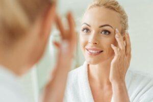 dermatology beautiful woman looking in mirror